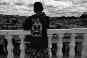 Chapter Three Guatemala, Guatemala An adolescent boy looks out over the gang controlled barrio where he lives.